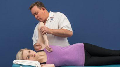 Dr Stoxen treating a patients shoulder at Team Doctors